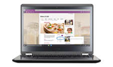 A Windows laptop with OneNote opened, with various snapped photos and ideas written by touch or stylus.